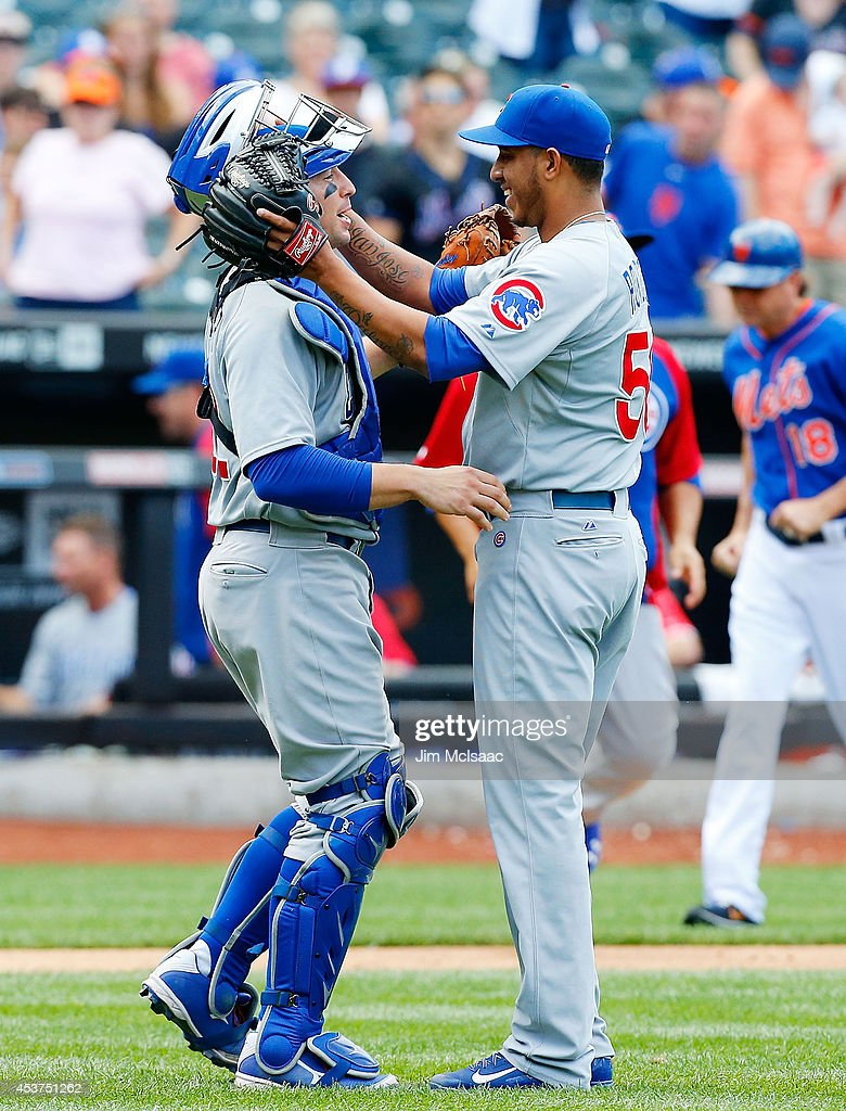 Hector Rondon #56 and catcher John Baker #12 of the Chicago Cubs celebrate after defeating the New York Mets at Citi Field on August 17, 2014 in the Flushing neighborhood of the Queens borough of New York City.
