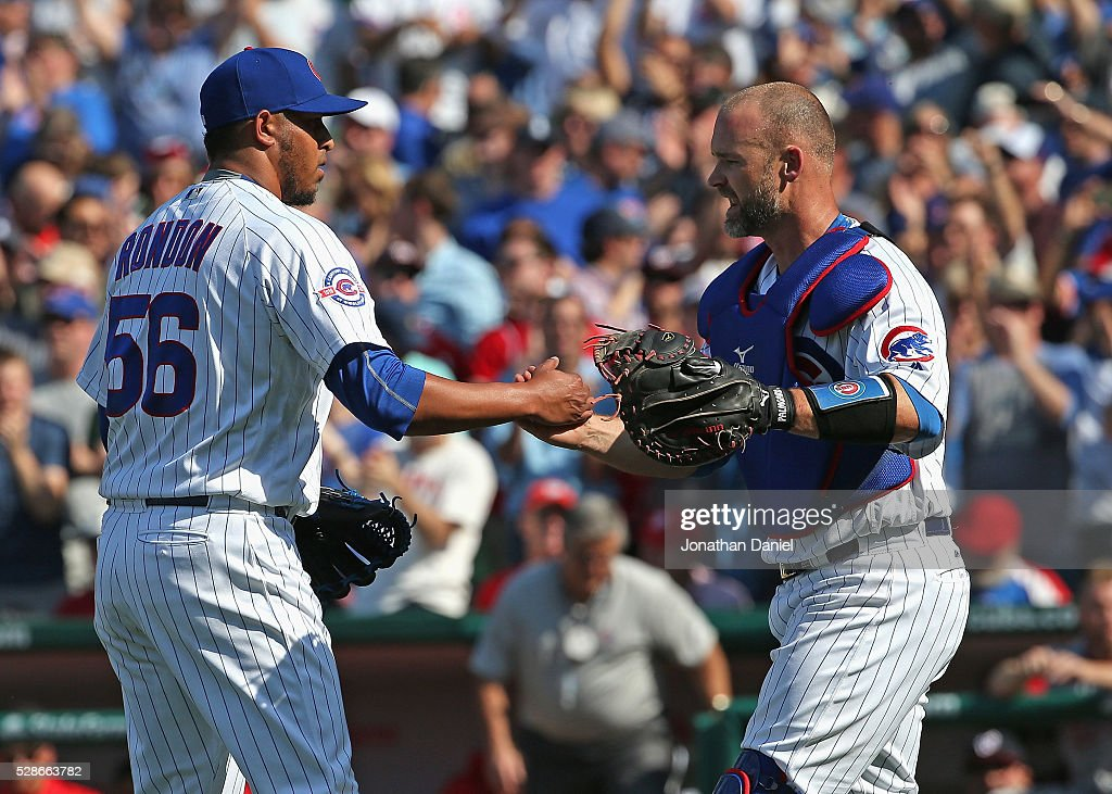 Hector Rondon #56 (L) and David Ross #3 of the Chicago Cubs celebrate a win over the Washington Nationals at Wrigley Field on May 6, 2016 in Chicago, Illinois. The Cubs defeated the Nationals 8-6.