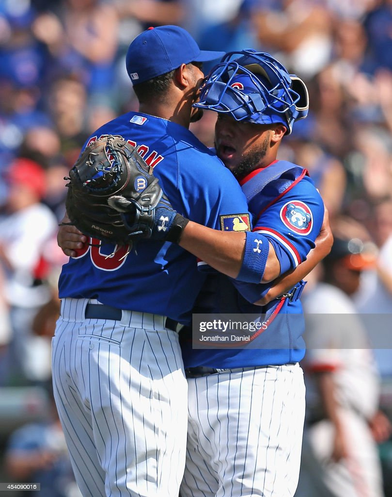 Hector Rondon #56 (L) and <a gi-track='captionPersonalityLinkClicked' href=/galleries/search?phrase=Welington+Castillo&family=editorial&specificpeople=4959193 ng-click='$event.stopPropagation()'>Welington Castillo</a> #5 of the Chicago Cubs celebrate a win against the Baltimore Orioles at Wrigley Field on August 24, 2014 in Chicago, Illinois. The Cubs defeated the Orioles 2-1.