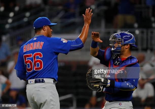 Hector Rondon and Willson Contreras of the Chicago Cubs celebrate their 51 win over the Atlanta Braves at SunTrust Park on July 18 2017 in Atlanta...