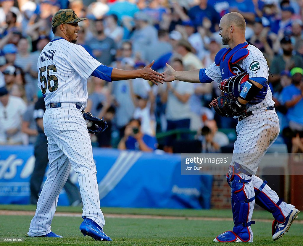 Hector Rondon #56 of the Chicago Cubs and <a gi-track='captionPersonalityLinkClicked' href=/galleries/search?phrase=David+Ross+-+Baseball+Player&family=editorial&specificpeople=210843 ng-click='$event.stopPropagation()'>David Ross</a> #3 shake hands after their win over the Los Angeles Dodgers at Wrigley Field on May 30, 2016 in Chicago, Illinois. The Chicago Cubs won 2-0.