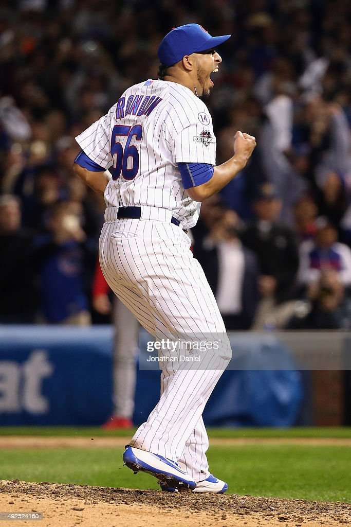 Hector Rondon #56 of the Chicago Cubs celebrates defeating the St. Louis Cardinals 6-4 in game four of the National League Division Series at Wrigley Field on October 13, 2015 in Chicago, Illinois.