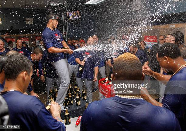 Hector Rondon of the Chicago Cubs celebrates in the locker room after defeating the Pittsburgh Pirates in the National League Wild Card game at PNC...