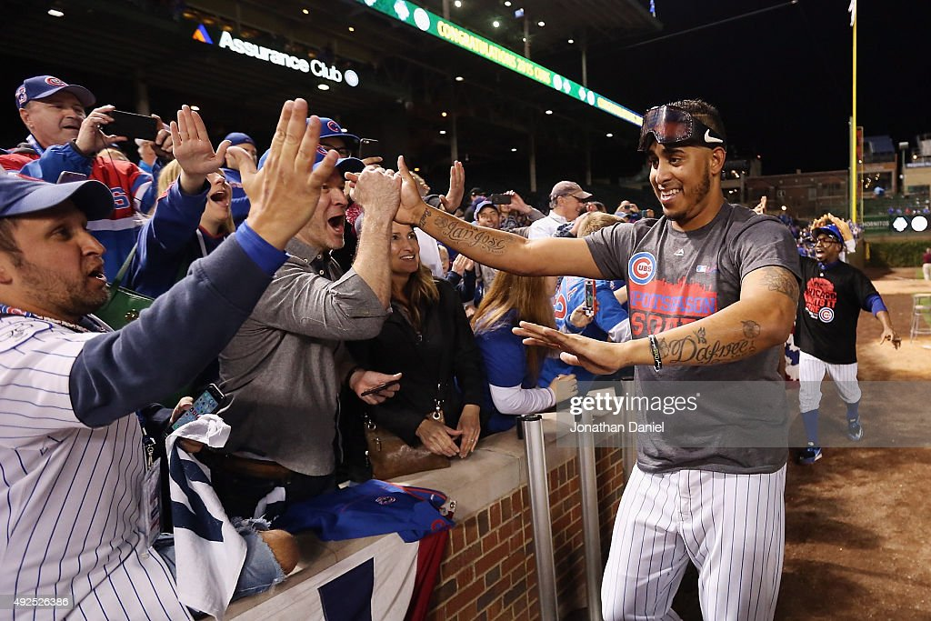 Hector Rondon #56 of the Chicago Cubs celebrates with fans after defeating the St. Louis Cardinals in game four of the National League Division Series to win the NLDS 3-1 at Wrigley Field on October 13, 2015 in Chicago, Illinois. The Chicago Cubs defeat the St. Louis Cardinals with a score of 6 to 4.