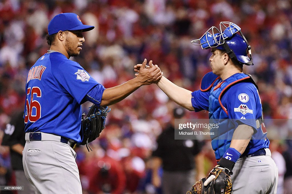 Hector Rondon #56 of the Chicago Cubs celebrates with Miguel Montero #47 of the Chicago Cubs after the Chicago Cubs defeat the St. Louis Cardinals in game two of the National League Division Series at Busch Stadium on October 10, 2015 in St Louis, Missouri. The Chicago Cubs defeat the St. Louis Cardinals with a score of 6 to 3.