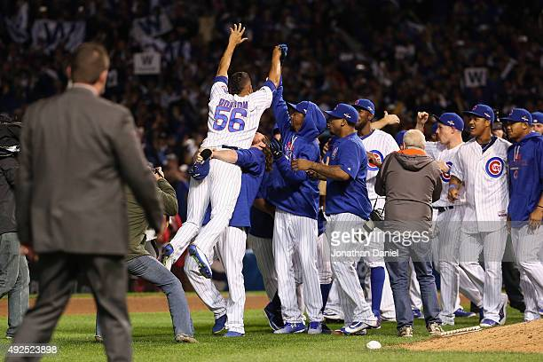 Hector Rondon of the Chicago Cubs celebrates with teammates after defeating the St Louis Cardinals 64 in game four of the National League Division...