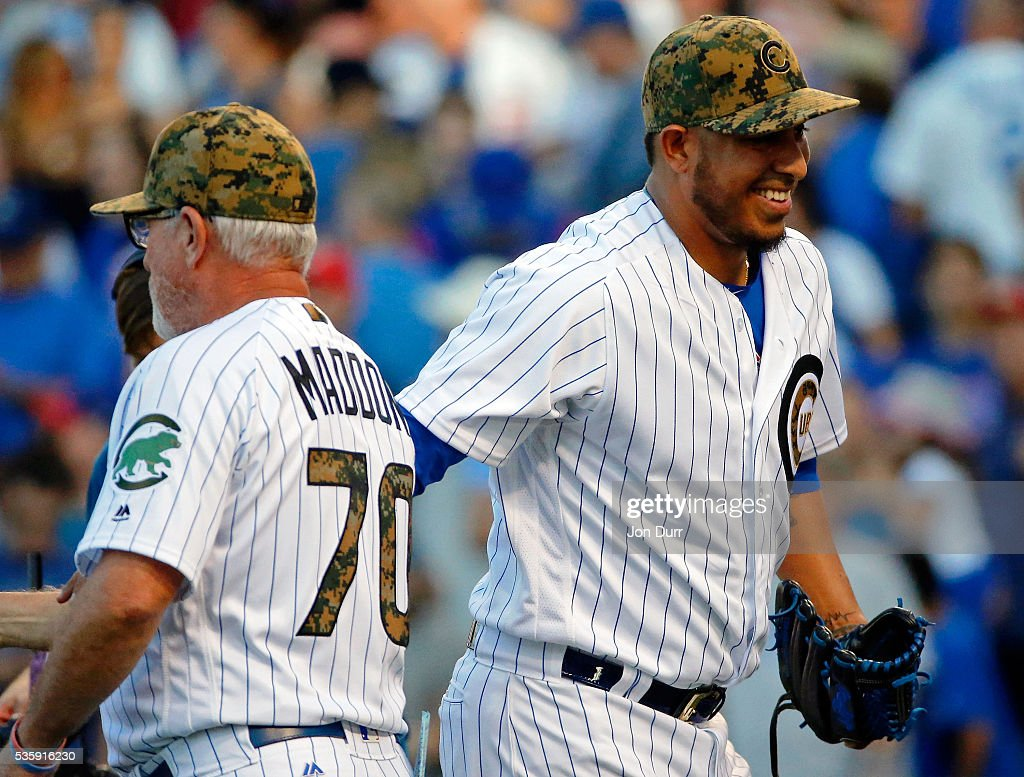 Hector Rondon #56 of the Chicago Cubs is congratulated by manager <a gi-track='captionPersonalityLinkClicked' href=/galleries/search?phrase=Joe+Maddon&family=editorial&specificpeople=568433 ng-click='$event.stopPropagation()'>Joe Maddon</a> #70 after their win against the Los Angeles Dodgers at Wrigley Field on May 30, 2016 in Chicago, Illinois. The Chicago Cubs won 2-0.
