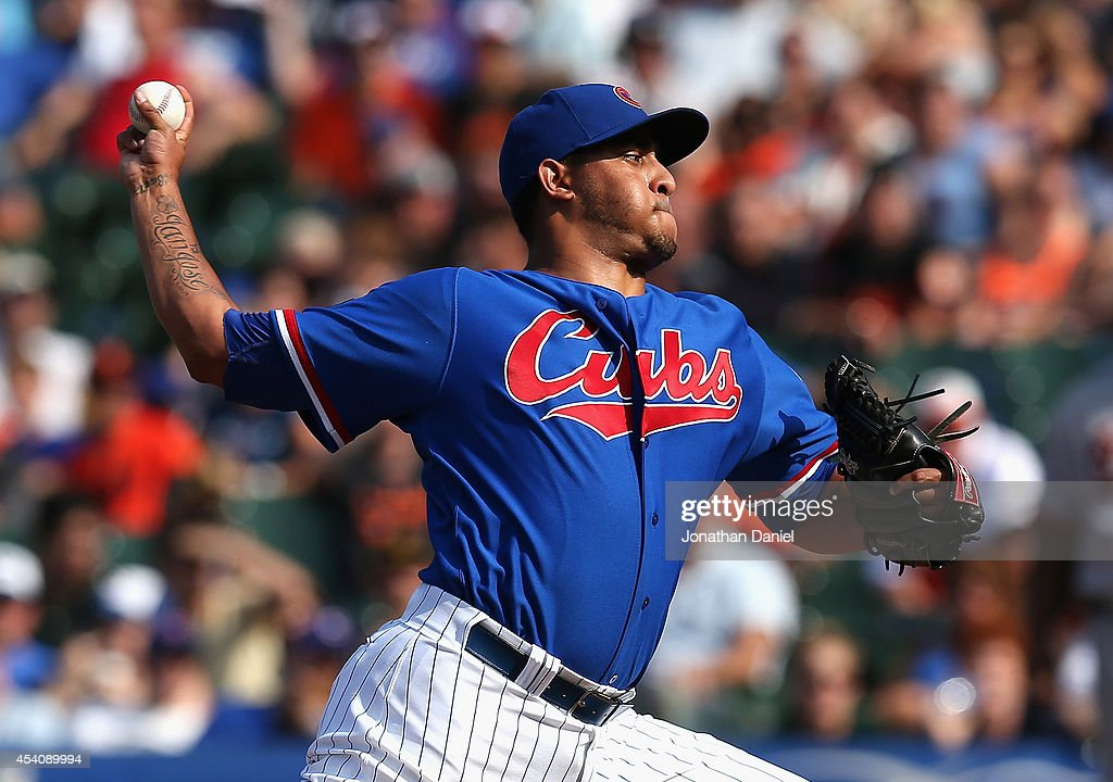 Hector Rondon #56 of the Chicago Cubs pitches in the 9th inning for his 21st save of the year against the Baltimore Orioles at Wrigley Field on August 24, 2014 in Chicago, Illinois. The Cubs defeated the Orioles 2-1.