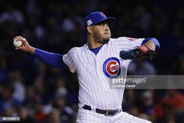 Hector Rondon of the Chicago Cubs pitches in the eighth inning against the Los Angeles Dodgers during game three of the National League Championship...