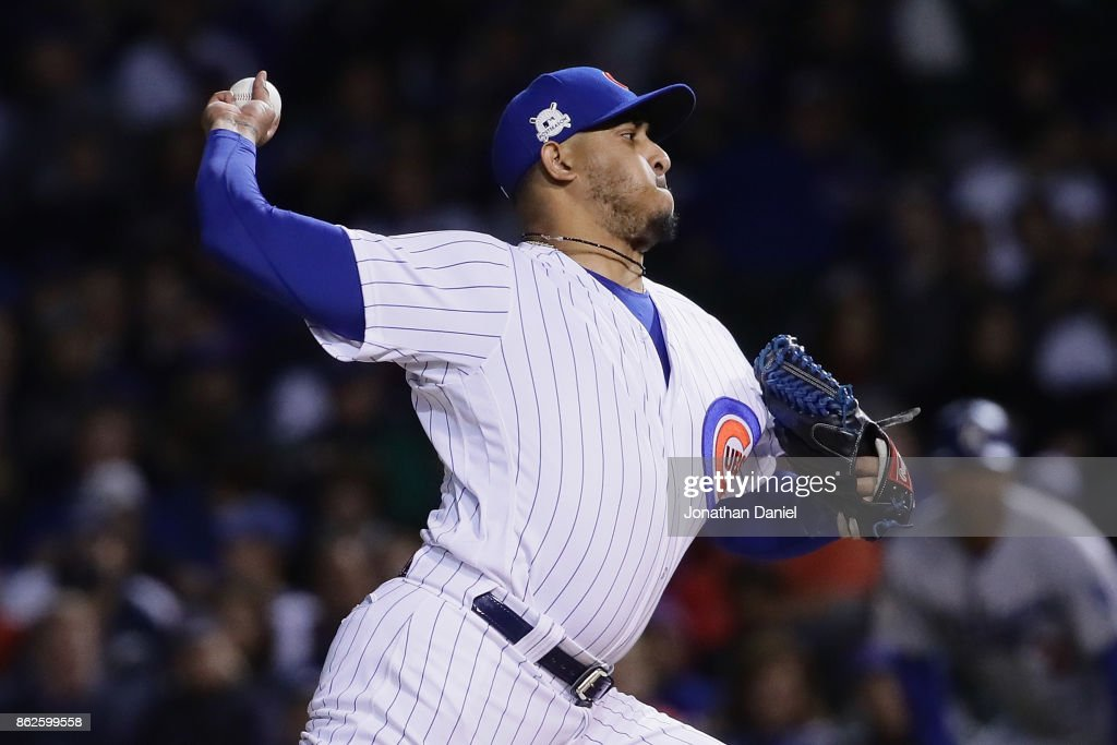 Hector Rondon #56 of the Chicago Cubs pitches in the eighth inning against the Los Angeles Dodgers during game three of the National League Championship Series at Wrigley Field on October 17, 2017 in Chicago, Illinois.