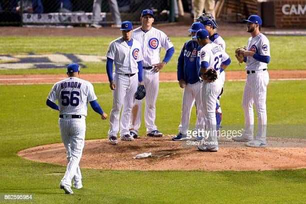Hector Rondon of the Chicago Cubs walks to the mound during a pitching change in the eighth inning against the Los Angeles Dodgers during game three...