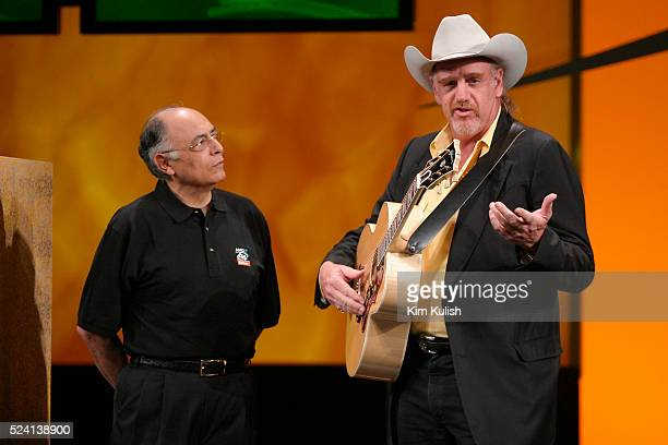 Hector Ruiz CEO of Advanced Micro Devices looks on as Ray Benson lead singer and guitarist for the western swing band Asleep At The Wheel performs at...