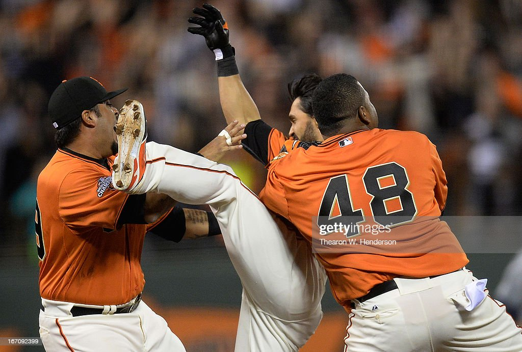 Hector Sanchez #29, <a gi-track='captionPersonalityLinkClicked' href=/galleries/search?phrase=Angel+Pagan&family=editorial&specificpeople=666596 ng-click='$event.stopPropagation()'>Angel Pagan</a> #16 and <a gi-track='captionPersonalityLinkClicked' href=/galleries/search?phrase=Pablo+Sandoval&family=editorial&specificpeople=803207 ng-click='$event.stopPropagation()'>Pablo Sandoval</a> #48 of the San Francisco Giants celebrate after Pagan hit an RBI walk-off single against the San Diego Padres in the ninth inning at AT&T Park on April 19, 2013 in San Francisco, California. The Giants won the game 3-2.