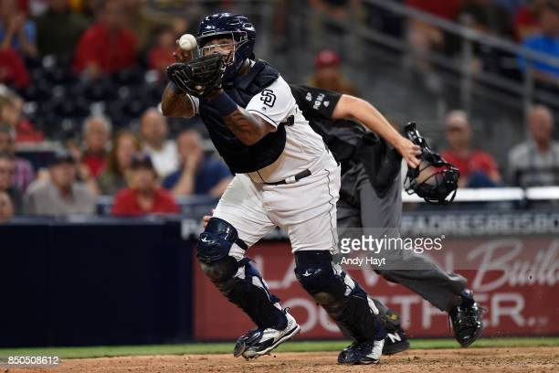 Hector Sanchez of the San Diego Padres catches a foul tip during the game against the St Louis Cardinals at Petco Park on September 6 2017 in San...