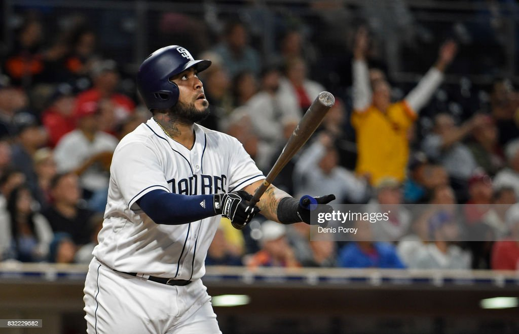 Hector Sanchez #44 of the San Diego Padres hits a two run home run during the fifth inning of a baseball game against the Philadelphia Phillies at PETCO Park on August 15, 2017 in San Diego, California.