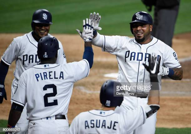 Hector Sanchez of the San Diego Padres right is congratulated by Jose Pirela after hitting a tworun home run during the eighth inning of a baseball...