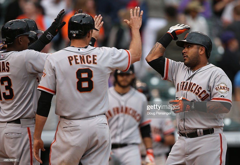 Hector Sanchez #29 of the San Francisco Giants celebrates his game winning grand slam home run off of Chad Bettis #35 of the Colorado Rockies with <a gi-track='captionPersonalityLinkClicked' href=/galleries/search?phrase=Hunter+Pence&family=editorial&specificpeople=757341 ng-click='$event.stopPropagation()'>Hunter Pence</a> #8 and Joaquin Arias #13 of the San Francisco Giants in the 11th inning at Coors Field on April 23, 2014 in Denver, Colorado. The Giants defeated the Rockies 12-10 in 11 innings.