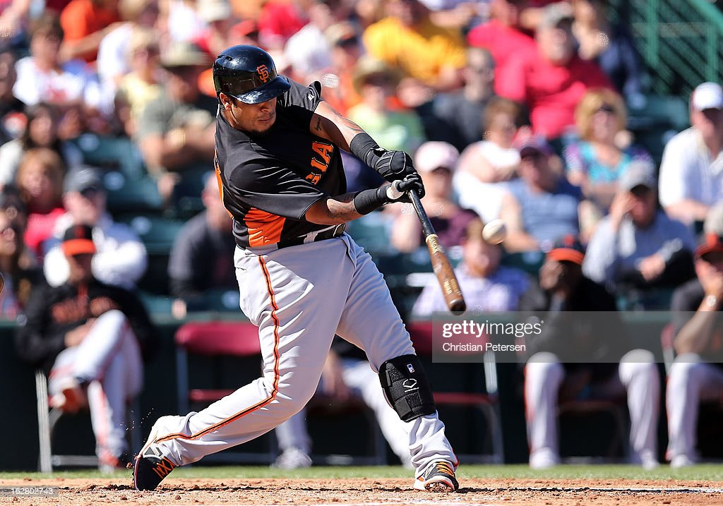 Hector Sanchez #29 of the San Francisco Giants hits a second inning RBI double against the Los Angeles Angels during the spring training game at Tempe Diablo Stadium on February 27, 2013 in Tempe, Arizona.