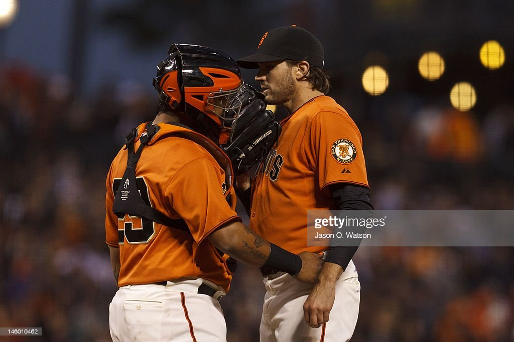 Hector Sanchez #29 of the San Francisco Giants (left) talks to Barry Zito #75 on the pitchers mound during the sixth inning of an interleague game against the Texas Rangers at AT&T Park on June 8, 2012 in San Francisco, California.