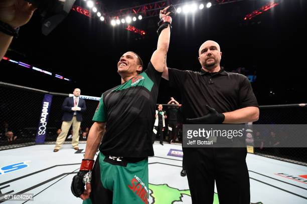 Hector Sandoval celebrates after knocking out Matt Schnell in their flyweight bout during the UFC Fight Night event at Bridgestone Arena on April 22...