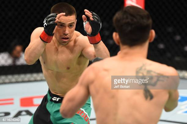 Hector Sandoval looks to strike Matt Schnell in their flyweight bout during the UFC Fight Night event at Bridgestone Arena on April 22 2017 in...
