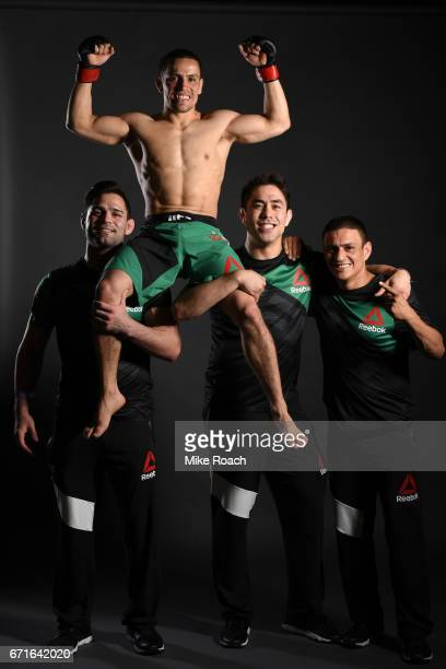 Hector Sandoval of Mexico poses for a portrait with his team backstage after his victory over Matt Schnell during the UFC Fight Night event at...
