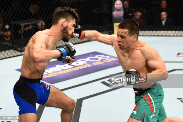 Hector Sandoval punches Matt Schnell in their flyweight bout during the UFC Fight Night event at Bridgestone Arena on April 22 2017 in Nashville...