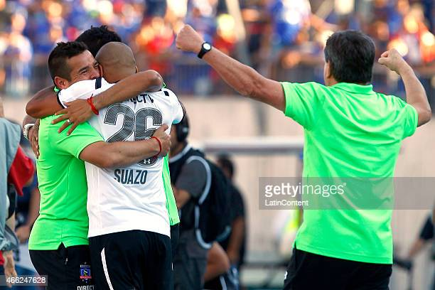 Hector Tapia and Humberto Suazo of Colo Colo celebrate after winning a match between during a match between U de Chile and Colo Colo as part of round...