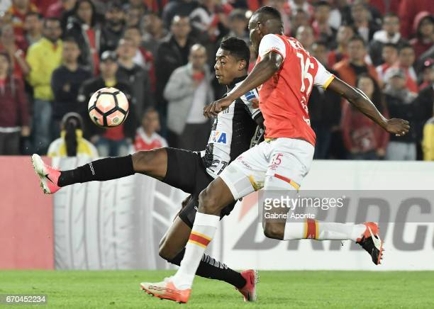 Hector Urrego of Santa Fe struggles for the ball with Bruno Henrique of Santos during a group stage match between Independiente Santa Fe v Santos as...