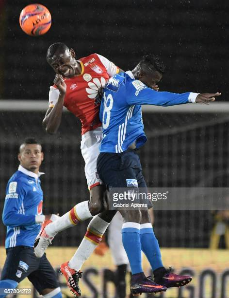 Hector Urrego of Santa Fe struggles for the ball with Duvier Riascos of Millonarios during the match between Santa Fe and Millonarios as part of the...