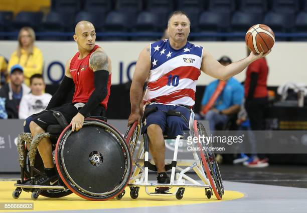 Hector Varela of Team USA looks to make a pass away from the coverage by Maurice Manuel of Team Denmark in a semifinal game on Day Eight in...