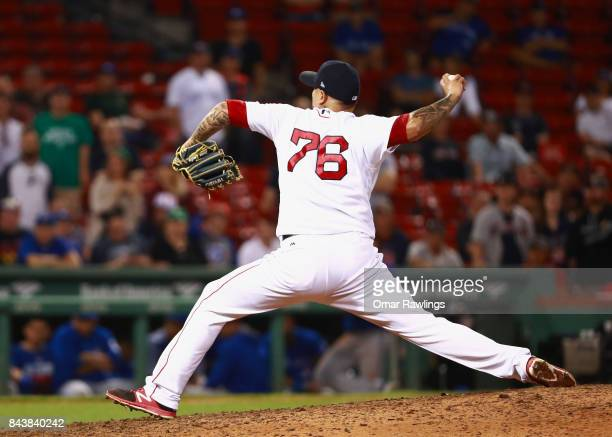 Hector Velazquez of the Boston Red Sox pitches iat the top of the nineteenth inning during the game against the Toronto Blue Jays at Fenway Park on...