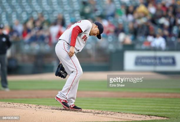 Hector Velazquez of the Boston Red Sox reacts after giving up a home run toKhris Davis of the Oakland Athletics in the first inning at Oakland...