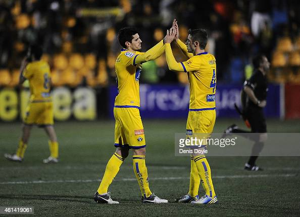 Hector Verdes and Jose Manuel alias 'Chema' of AD Alcorcon celebrate after their team beat Espanyol 10 in the Copa del Rey Round of 16 1st leg match...