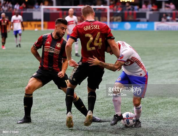 Hector Villalba and Julian Gressel of Atlanta United challenge Sebastian Giovinco of Toronto FC at MercedesBenz Stadium on October 22 2017 in Atlanta...