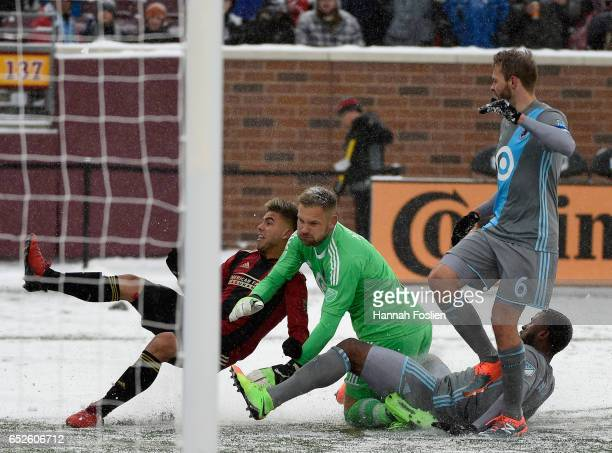 Hector Villalba of Atlanta United FC and Jermaine Taylor of Minnesota United FC collide with goalkeeper John Alvbage of Minnesota United FC during...