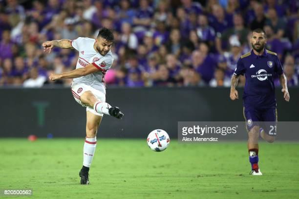 Hector Villalba of Atlanta United scores a goal in front of Antonio Nocerino of Orlando City SC during a MLS soccer match between Atlanta United FC...