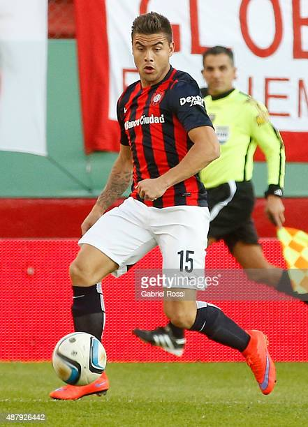 Hector Villalba of San Lorenzo drives the ball during a match between Huracan and San Lorenzo as part of 24th round of Torneo Primera Division 2015...