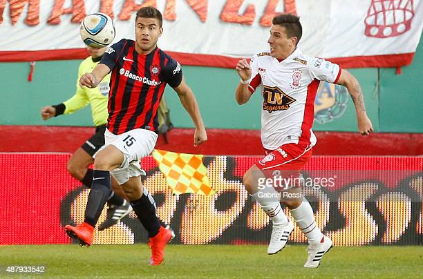 Hector Villalba of San Lorenzo fights for the ball with Carlos Arano of Huracan during a match between Huracan and San Lorenzo as part of 24th round...