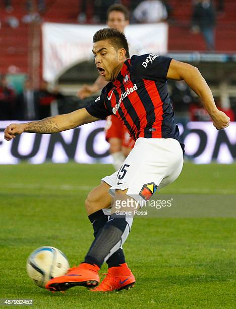 Hector Villalba of San Lorenzo kicks the ball during a match between Huracan and San Lorenzo as part of 24th round of Torneo Primera Division 2015 at...