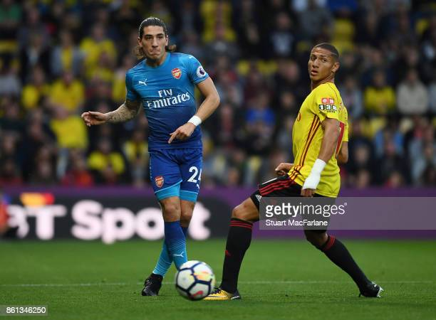 Hectro Bellerin of Arsenal challenges by Richarlison of Watford during the Premier League match between Watford and Arsenal at Vicarage Road on...