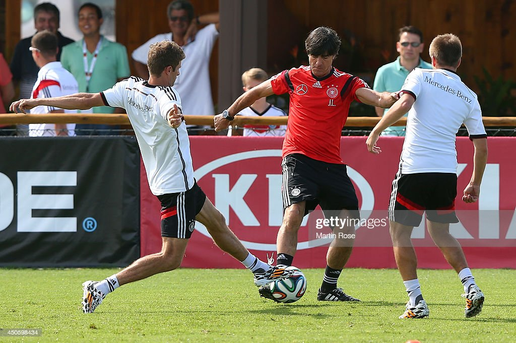 Hed cooach Joachim Loew (R) battles for the ball with Thomas Mueller during the German National team training at Campo Bahia on June 14, 2014 in Santo Andre, Brazil.