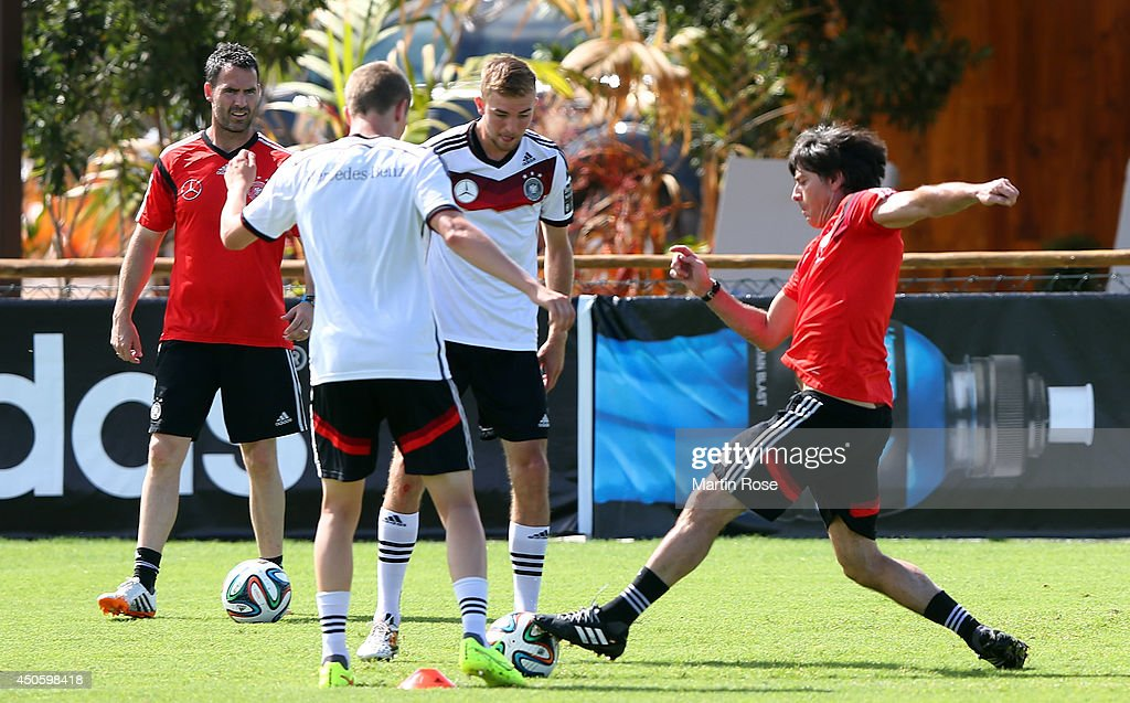 Hed cooach <a gi-track='captionPersonalityLinkClicked' href=/galleries/search?phrase=Joachim+Loew&family=editorial&specificpeople=215315 ng-click='$event.stopPropagation()'>Joachim Loew</a> (R) in action during the German National team training at Campo Bahia on June 14, 2014 in Santo Andre, Brazil.