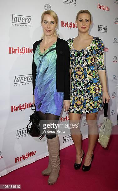 Hedda Deilmann and Jaqueline Deilmann attend the BRIGITTE fashion event at the Hamburg Cruise Center on January 28 2011 in Hamburg Germany