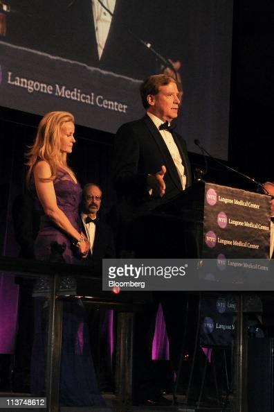 Hedge fund manager Stanley Druckenmiller right speaks while his wife Fiona Druckenmiller listens at the Langone Medical Center Violet Ball in New...