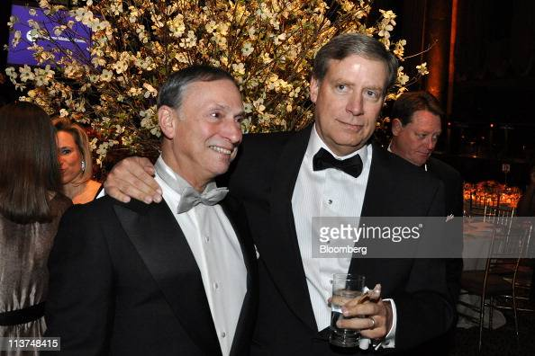 Hedge fund manager Stanley Druckenmiller right stands for a photograph with Dr Robert Grossman dean of New York University's Langone Medical Center...