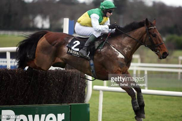 Hedgehunter jumps clear to come second afetr winning horse Beef or Salmon wins the Hennessy Cognac Gold Cup at leopardstown