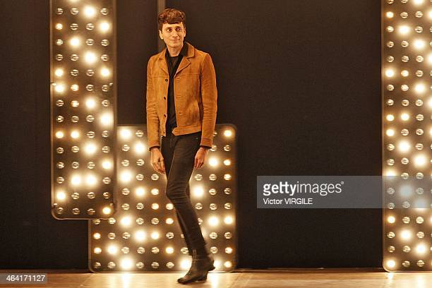 Hedi Slimane walks the runway at the Saint Laurent Autumn Winter 2014 fashion show during Paris Menswear Fashion Week on January 19 2014 in Paris...