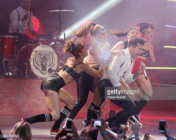 TORONTO ON JUNE 15 Hedley fronted by Jacob Hoggard perform 'Crazy for You' at the Much Music Video Awards at MuchMusic on Queen Street West in...