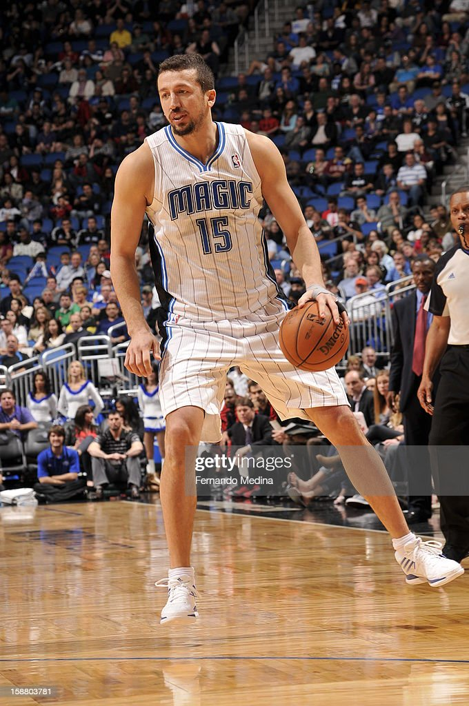 Hedo Turkoglu #15 of the Orlando Magic dribbles the ball up the floor against the Toronto Raptors during the game on December 29, 2012 at Amway Center in Orlando, Florida.